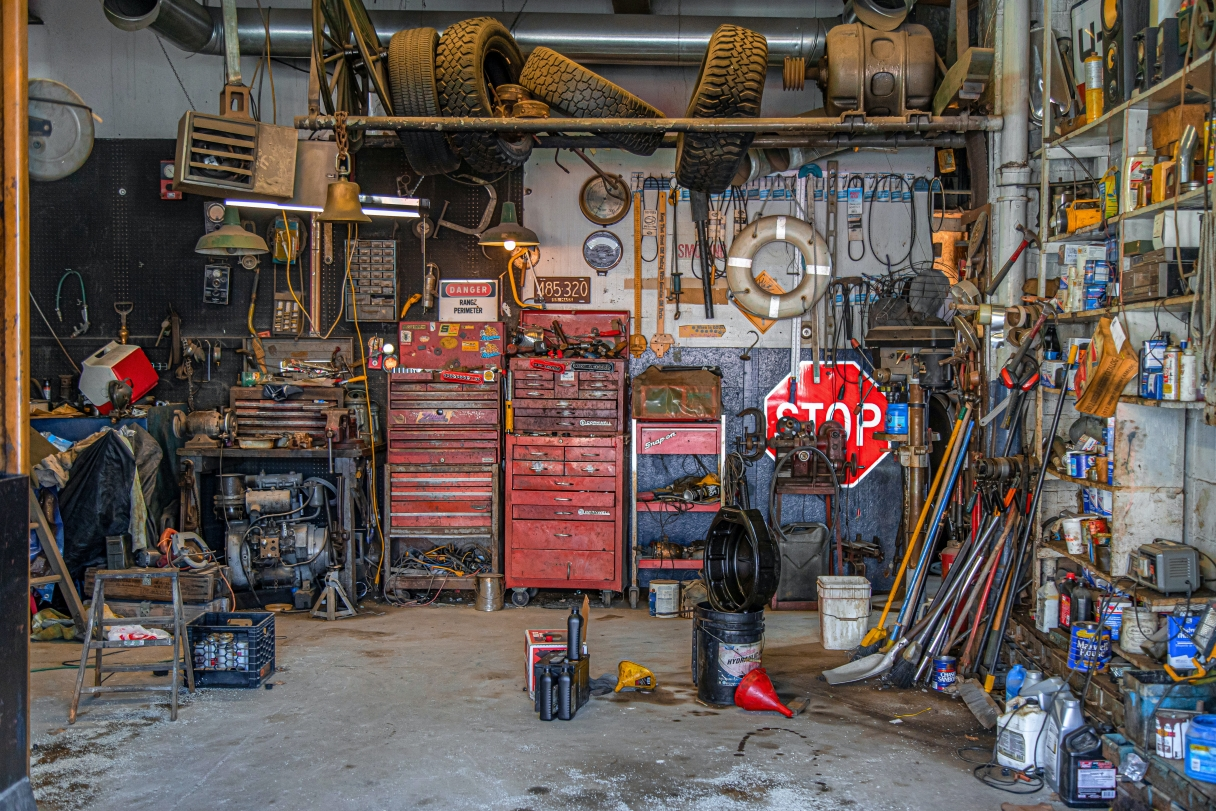 A well-used mechanic's stop with every tool, tire and hose and clamp, but no car