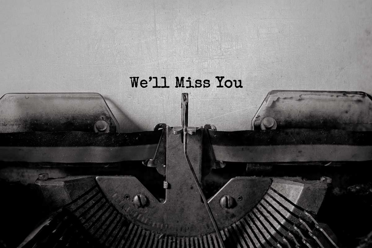 Paper in a typewriter with 'We'll Miss You' typed out